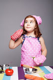Cooking love. 3 year old ginger girl loves cooking and thinking what to cook Stock Photography