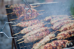 Cooking of lula kebab on the grill at picnic Royalty Free Stock Photo