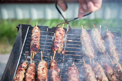 Cooking of lula kebab on the grill at picnic Stock Photography