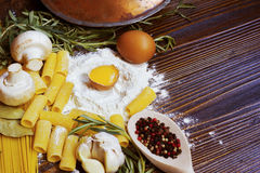 Cooking macaroni ingredients spices egg  rosemary Royalty Free Stock Photography
