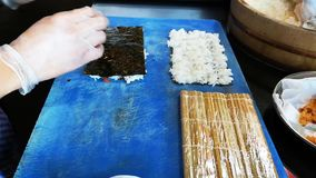 Cooking making fresh and delicious variety of maki and nigiri sushi.  stock footage