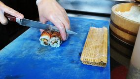 Cooking making fresh and delicious variety of maki and nigiri sushi.  stock video