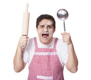 Cooking man with kitchenware Royalty Free Stock Images