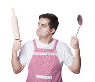 Cooking man with kitchenware Stock Photo