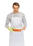 Cooking man over white Stock Photos