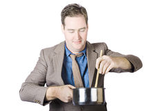 Cooking man stirring food with wooden spoon Royalty Free Stock Image