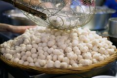 Cooking with fish ball. Cooking with many fish ball prepare for noodles Royalty Free Stock Photography
