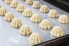 Cooking many sweet meringue on production line. sweet food concept.  stock photography