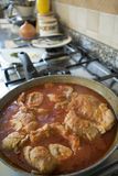 Cooking marrowbone in pan with tomato sauce Royalty Free Stock Image