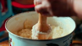 Cooking mashed potatoes. Woman chef preparing a potato in the Domestic Kitchen. Cooking food at home. Home atmosphere in stock footage