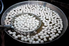 Cooking meat balls in hot pot.Boiled meat ball in hot water in asia tradition street market royalty free stock image