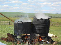 Cooking meat in the boilers, shamanic people of Siberia, Buryats Royalty Free Stock Photography