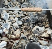 Cooking meat on the coals Royalty Free Stock Photography