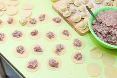 Cooking meat dumplings (pelmeni) Royalty Free Stock Photo