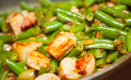 Cooking meat with green beans in pan. Cooking meat with green beans in fried pan Royalty Free Stock Photo