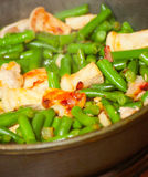 Cooking meat with green beans in pan Royalty Free Stock Photos