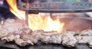 Cooking meat in grill bbq stock video