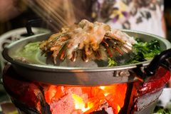 Hot pan grill meat charcoal stove Stock Images