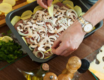 Cooking  meat with  mushrooms and portatoes Royalty Free Stock Photo