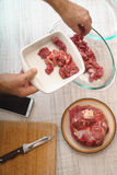 Cooking meat with recipe from internet Stock Images