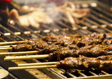 Cooking meat skewers Royalty Free Stock Photography