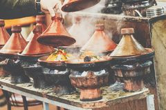 Cooking of meat in traditional Moroccan ceramic tajine dish, Mar Stock Photography