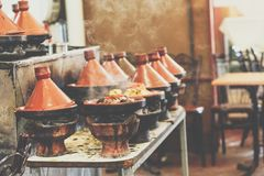 Cooking of meat in traditional Moroccan ceramic tajine dish, Mar Royalty Free Stock Photo