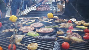 Cooking of meat and vegetables on the barbecue. Cooking of meat and vegetables on the grill. hand using tongs for turning meat on the barbecue. Sausages, chicken stock video footage