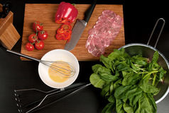 Cooking meat and vegetables stock images