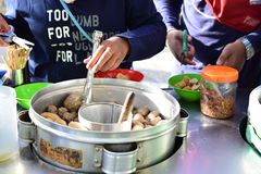 Buying meatball outdoor in the playground royalty free stock images