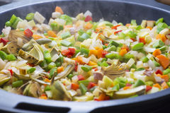 Cooking Mediterranean vegetables on a pan Royalty Free Stock Photos