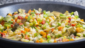 Cooking Mediterranean vegetables on a pan Royalty Free Stock Photo