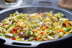 Cooking Mediterranean vegetables on a pan Stock Image