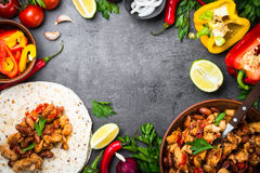 Cooking Mexican taco with meat beans and vegetables. Cooking Mexican taco with meat beans and vegetables at black slate table. Latin american food background Royalty Free Stock Images