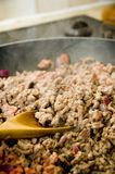 Cooking mince. Mince meat gently browning off in a pan Royalty Free Stock Images