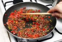 Cooking Minced meat sauce royalty free stock image