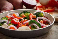 Cooking mixed vegetables. Cooking mixed raw and fresh vegetables Royalty Free Stock Image