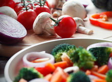 Mixed vegetables. Cooking mixed vegetables on wooden table Royalty Free Stock Photo