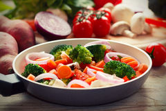 Mixed vegetables. Cooking mixed vegetables, on wooden table Royalty Free Stock Photos