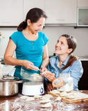 Cooking mother with adult daughter Stock Image