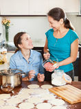 Cooking mother with adult daughter Stock Photography