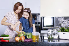Cooking. Mother with little daughter Royalty Free Stock Photo
