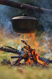 Cauldron on fire Stock Images