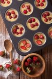 Cooking muffins with fresh strawberries vertical top view Royalty Free Stock Image