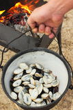 Cooking mussels in a large pot Stock Photo