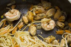 Cooking Mussels pasta Stock Photos