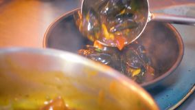 Cooking mussels in seafood asian restaurant stock footage