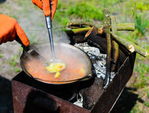 Cooking in nature picnic  pot on a firewood Royalty Free Stock Photography
