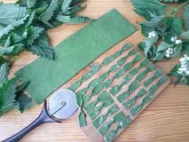 Cooking nettles green farfalle pasta. With wild plants royalty free stock images