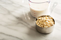 Cooking oatmeal with oats and milk Stock Photography